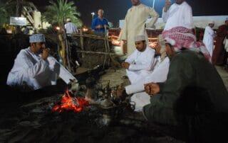 Omani men enjoying an evening in the soukh